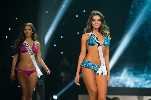 A handout image provided by the Miss Universe Organization on 17 December 2015 shows Sarah-Lorraine Riek (Front), Miss Germany 2015 and Janet Kerdikoshvili, Miss Georgia 2015 competing on stage in Yamamay swimwear featuring footwear by Chinese Laundry at Planet Hollywood Resort and Casino in Las Vegas, Nevada, USA, 16 December 2015. The 2015 Miss Universe contestants are competing for the crown in Las Vegas on 20 December. (Photo by Darren Decker/EPA)