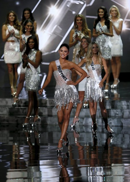 Miss Philippines Pia Alonzo Wurtzbach (C) walks to the front of the stage as she is announced as a finalist during the 2015 Miss Universe Pageant in Las Vegas, Nevada December 20, 2015. (Photo by Steve Marcus/Reuters)