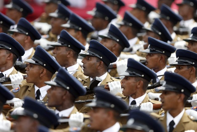 Sri Lanka's police officers march during the country's 67th Independence day celebrations in Colombo February 4, 2015. (Photo by Dinuka Liyanawatte/Reuters)