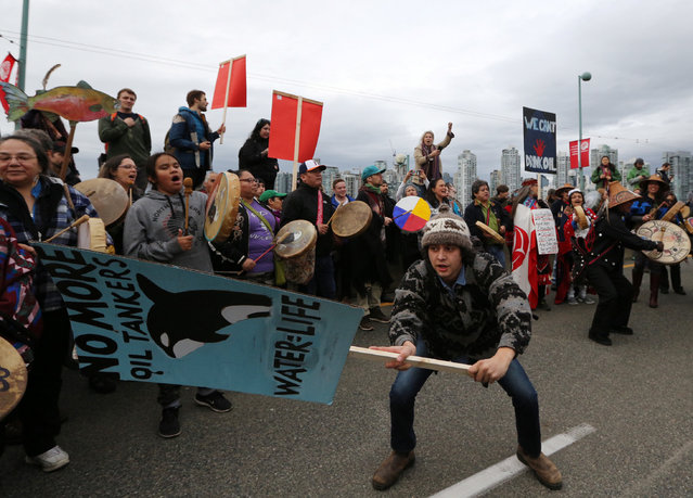 Marchers protesting against the proposed expansion of Kinder Morgan's Trans Mountain Pipeline walk towards downtown Vancouver, B.C., Canada November 19, 2016. (Photo by Chris Helgren/Reuters)