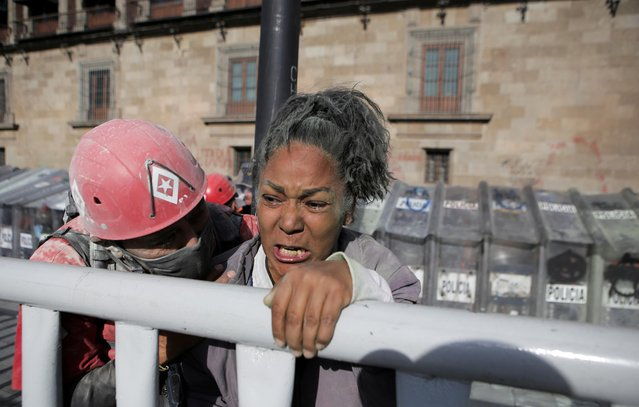 A woman reacts during a protest in support of Victoria Salazar, a Salvadoran woman who died after a Mexican female police officer was seen in a video kneeling on her back, in Mexico City, Mexico on April 2, 2021. (Photo by Raquel Cunha/Reuters)