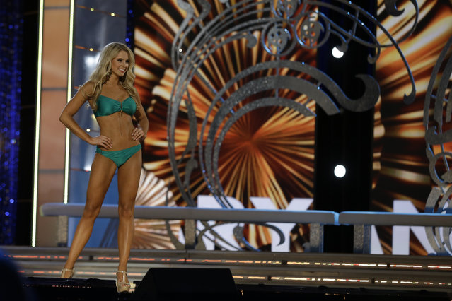 Miss Maryland Christina Denny displays her swimsuit during the Miss America 2014 pageant, Sunday, September 15, 2013, in Atlantic City, N.J. (Photo by Mel Evans/AP Photo)