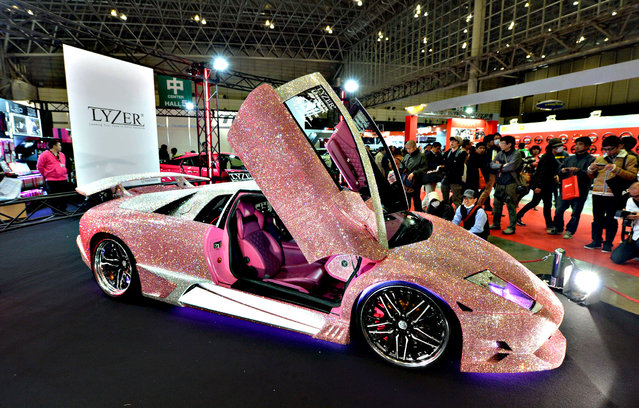 Japan's LED and HID parts manufacturer LYZER displays a demo car, the Lamborghini Murcielago finished with pink Swarovski crystals on the whole body, at Tokyo Auto Salon 2016 at Makuhari Messe in Chiba on January 15, 2016. The exhibition, one of the largest annual custom car and car-related product show, held here over the three-day period from January 15 to January 17. (Photo by Kazuhiro Nogi/AFP Photo)