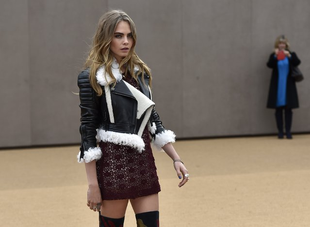Model Cara Delavigne arrives for the Burberry Autumn/Winter 2015 collection show at London Fashion Week in London February 23, 2015. (Photo by Toby Melville/Reuters)