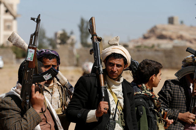 Tribesmen attend a gathering held to show support to the new government formed by Yemen's armed Houthi movement and its political allies, in Sanaa, Yemen December 6, 2016. (Photo by Khaled Abdullah/Reuters)