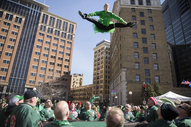 Sara LeBlanc of the St. Paul Bouncing Team performs during the 49th annual St. Patrick's Day parade in downtown St. Paul on Tuesday, March 17, 2015. (Photo by Leila Navidi/The Star Tribune)