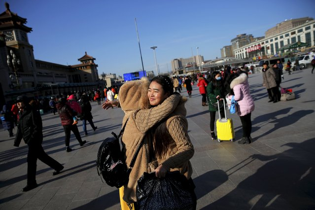Passengers say their good-byes at the Beijing Railway Station as migration for the annual Spring Festival begins in central Beijing, January 24, 2016. (Photo by Damir Sagolj/Reuters)