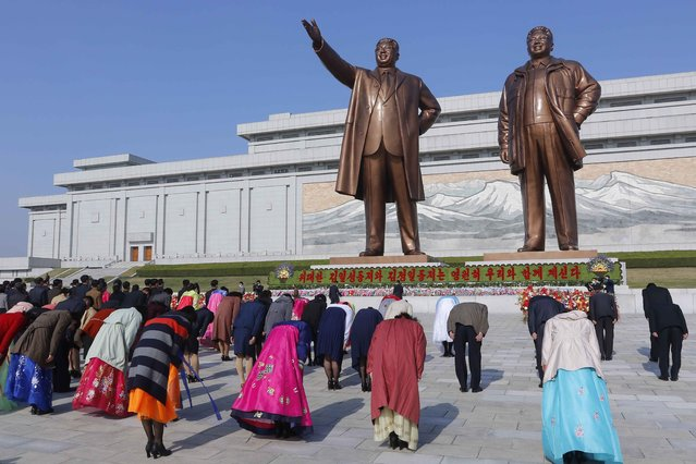 People visit the statues of their late leaders Kim Il Sung and Kim Jong Il on the occasion of the Day of the Sun, the birth anniversary of Kim Il Sung, in Pyongyang, North Korea Thursday, April 15, 2021. (Photo by Cha Song Ho/AP Photo)