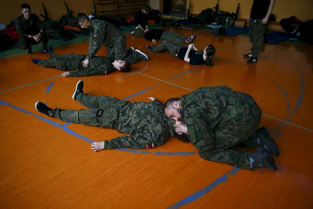 Robert Przybyl checks breath as he takes part in a medical course organised by paramilitary organisation called Obrona Narodowa (National Defence) in Mrozy near Minsk Mazowiecki, eastern Poland February 28, 2014. (Photo by Kacper Pempel/Reuters)