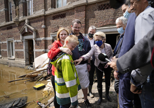 European Commission President Ursula von der Leyen, center, speaks with Madeline Brasseur, 37, Paul Brasseur, 42, and their son Samuel, 12 as she tours the village after flooding in Pepinster, Belgium, Saturday, July 17, 2021. Residents in several provinces were cleaning up after severe flooding in Germany and Belgium turned streams and streets into raging torrents that swept away cars and caused houses to collapse. (Photo by Virginia Mayo/AP Photo)