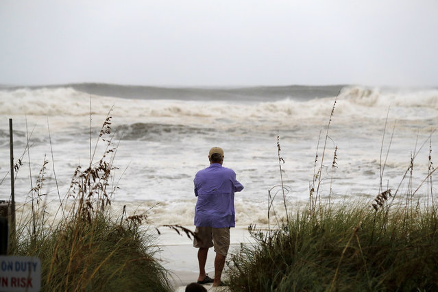 People photograph the surf from encroaching Hurricane Michael, which is expected to make landfall today, in Panama City Beach, Fla., Wednesday, October 10, 2018. The hurricane center says Michael will be the first Category 4 hurricane to make landfall on the Florida Panhandle. (Photo by Gerald Herbert/AP Photo)
