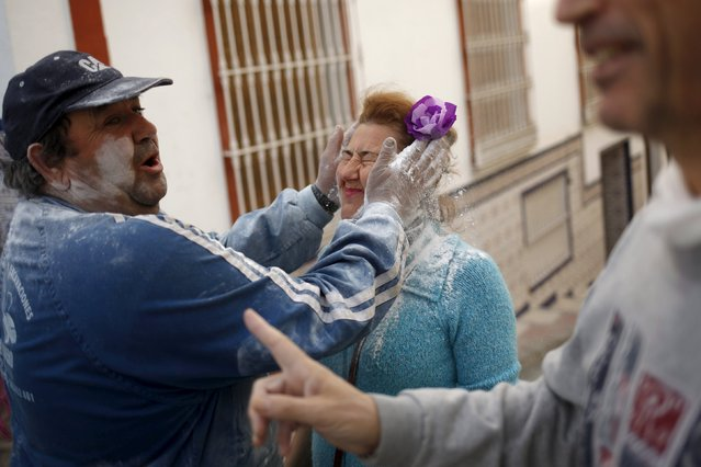 """A man covers the face of a woman with talcum powder during """"El Dia de los Polvos"""" (Powder Day) festival in Tolox, near Malaga, southern Spain, February 9, 2016. (Photo by Jon Nazca/Reuters)"""