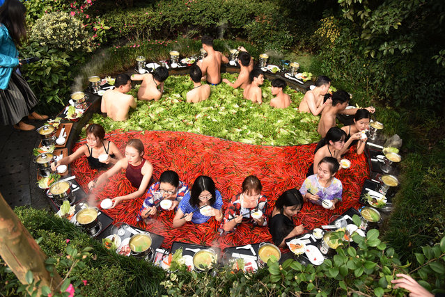 Tourists enjoy hot pot and spring at the hotpot shaped spring during winter at a hotel in Hangzhou, east China's Zhejiang Province on December 26, 2018. (Photo by Sipa Asia/Rex Features/Shutterstock)