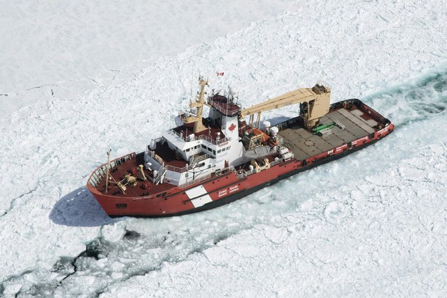 The Canadian Coast Guard Ship (CCGS) Samuel Risley is shown in this aerial photo near Whitefish Bay on Lake Superior northwest of Sault Ste. Marie, Ontario April 7, 2015. (Photo by Kenneth Armstrong/Reuters)