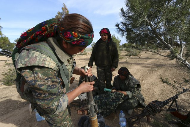 Fighters from the Democratic Forces of Syria prepare their weapons in the southwestern countryside of Hasaka, Syria February 17, 2016. Picture taken February 17, 2016. (Photo by Rodi Said/Reuters)
