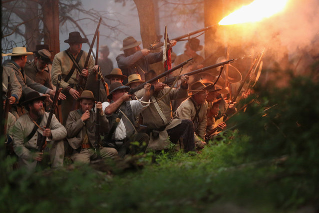Confederate Civil War re-enactors launch an evening attack during a three-day Battle of Gettysburg re-enactment on June 29, 2013 in Gettysburg, Pennsylvania. (Photo by John Moore/Getty Images)