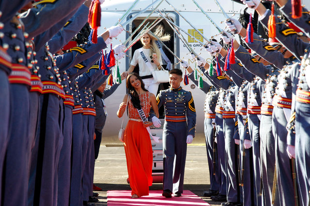 Miss Universe contestant Carolyn Carter of the U.S. Virgin Islands is greeted by cadets of the Philippine Military Academy (PMA) while Miss Norway Christina Waage disembarks from the plane, during their arrival at the airport in Baguio city, north of Manila, Philippines January 18, 2017. (Photo by Harley Palanchao/Reuters)