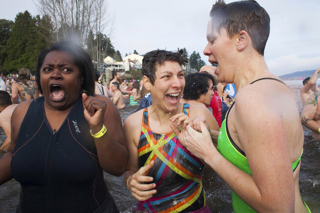 Participants react after entering Lake Washington during the 12th annual Polar Bear Plunge in Seattle, Washington January 1, 2014. (Photo by David Ryder/Reuters)
