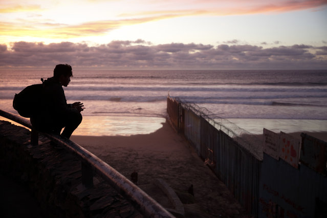 In this Wednesday, January 9, 2019, file photo a man looks towards where the border wall meets the Pacific Ocean in Tijuana, Mexico. With the standoff over paying for his long-promised border wall dragging on, the president's Oval Office address and visit to the Texas border over the past week failed to break the logjam and left aides and allies fearful that the president has misjudged Democratic resolve and is running out of negotiating options. (Photo by Gregory Bull/AP Photo)