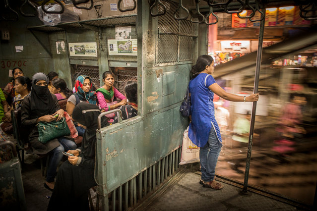 """""""Women's compartment"""". Mumbai, India. Every day 7.5m people make use of the suburban trains in Mumbai. It is the biggest suburban network in the world and almost every train has separate compartments for women, to avoid sexual harassment. (Photo by Tamina-Florentine Zuch)"""