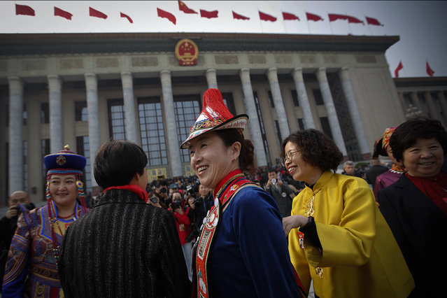 Minority delegates share a light moment as they arrive at the Great Hall of the People to attend the opening session of the Chinese People's Political Consultative Conference (CPPCC) in Beijing, Sunday, March 3, 2019. (Photo by Andy Wong/AP Photo)