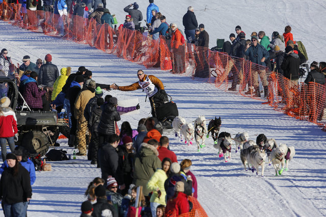 Rob Cooke's team leaves the start chute at the restart of the Iditarod Trail Sled Dog Race in Willow, Alaska March 6, 2016. (Photo by Nathaniel Wilder/Reuters)