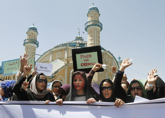 Afghan women chant slogans during a protest demanding justice for a woman who was beaten to death by a mob after being falsely accused of burning a Quran about two months ago, in downtown Kabul, Afghanistan, Monday, April 27, 2015. (Photo by Allauddin Khan/AP Photo)