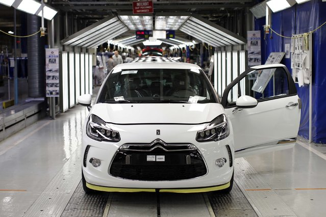 A DS 3 car is pictured in the final check area at the PSA Peugeot Citroen plant in Poissy, near Paris, France, April 29, 2015. (Photo by Benoit Tessier/Reuters)