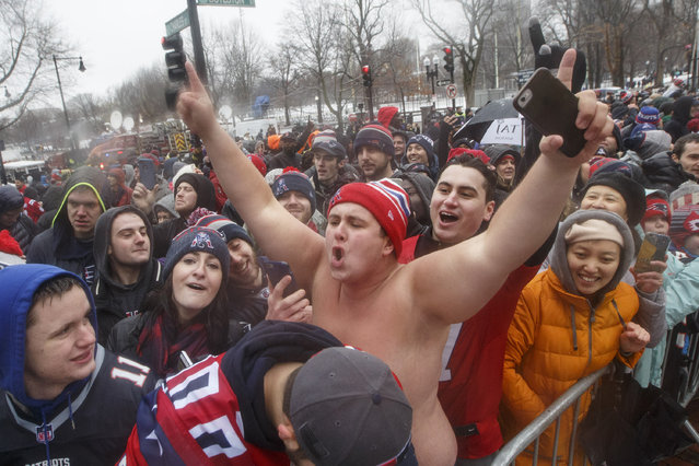 Fans cheer along the parade route during New England Patriots Super Bowl LI Victory Parade in Boston on February 7, 2017. (Photo by Keith Bedford/The Boston Globe via Getty Images)