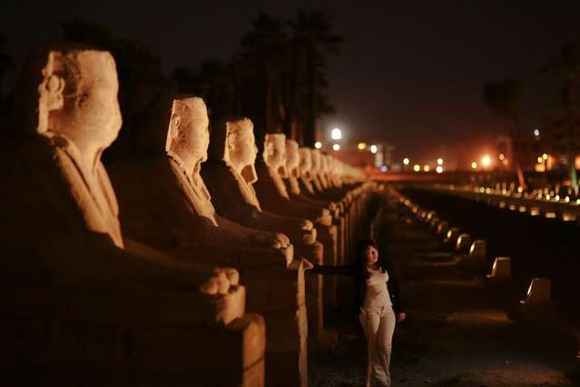 In this Friday, May 1, 2015 photo, a tourist poses for a photo in front of the avenue of sphinxes at Luxor Temple, in Luxor, 510 kilometers (320 miles) south of Cairo, Egypt. (Photo by Mosa'ab Elshamy/AP Photo)