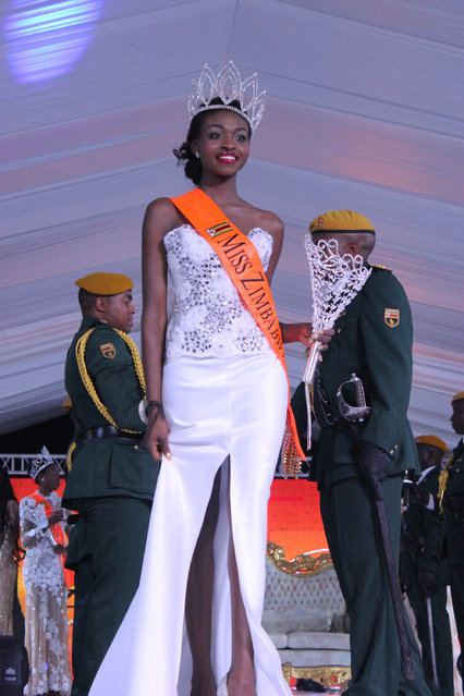In this Sunday, April, 26, 2015  photo Miss Zimbabwe, Emily Kachote, walks on  stage after been crowned. Organisers of the Miss Zimbabwes Peagant say they are investigating Kachote two weeks into her reign after photos allegedly showing her nude appeared on the Internet. (Photo by AP Photo)