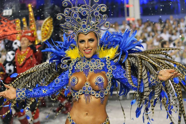 A dancer of the Gavioes da Fiel samba school performs during the second night of carnival parade at the Sambadrome in Sao Paulo. (Photo by Nelson Almeida/AFP Photo)