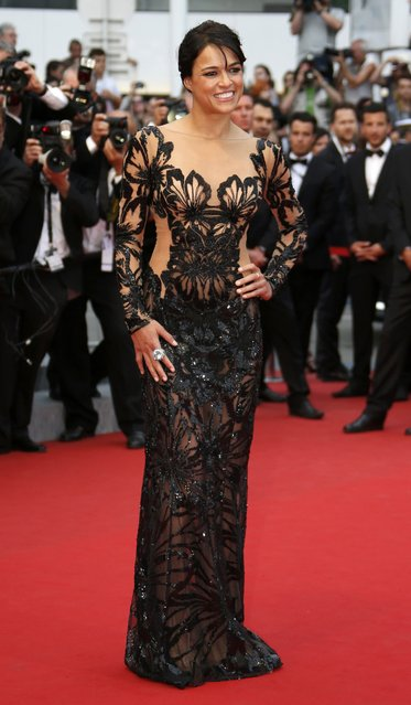 """Actress Michelle Rodriguez poses on the red carpet as she arrives for the screening of the film """"Mad Max: Fury Road"""" out of competition at the 68th Cannes Film Festival in Cannes, southern France, May 14, 2015. (Photo by Eric Gaillard/Reuters)"""