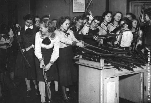 1939: Military training has been introduced to the schools in Budapest. Here the pupils of a girl's school are issued with their arms