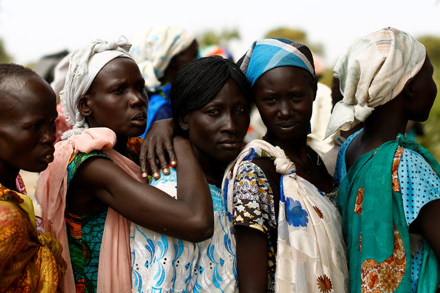 Women wait in line during a UNICEF supported mobile health clinic in the village of Rubkuai, Unity State, South Sudan, February 16, 2017. (Photo by Siegfried Modola/Reuters)