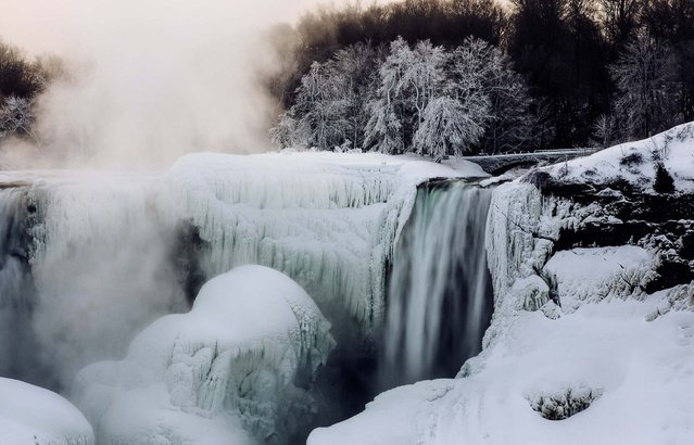A partially frozen Niagara Falls is seen on the American side during sub freezing temperatures in Niagara Falls, Ontario, March 3, 2014. (Photo by Mark Blinch/Reuters)