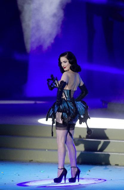 U.S. New Burlesque star Dita Von Teese presents couture by Jean Paul Gaultier during a fashion show at the opening ceremony of the Life Ball in front of City Hall in Vienna, Austria, Saturday, May 16, 2015. (Photo by Herwig Prammer/AP Photo)