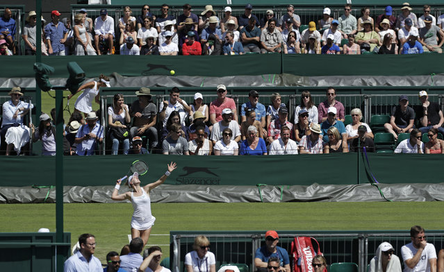 United States' Alison Riske serves to Serbia's Ivana Jorovic in a Women's singles match during day four of the Wimbledon Tennis Championships in London, Thursday, July 4, 2019. (Photo by Ben Curtis/AP Photo)