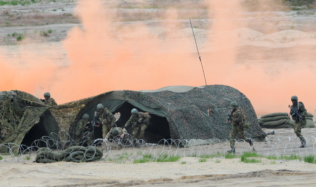 Soldiers take part in the NATO Noble Jump exercise on a training range near Swietoszow Zagan, Poland, Thursday, June 18, 2015. (AP Photo/Alik Keplicz)