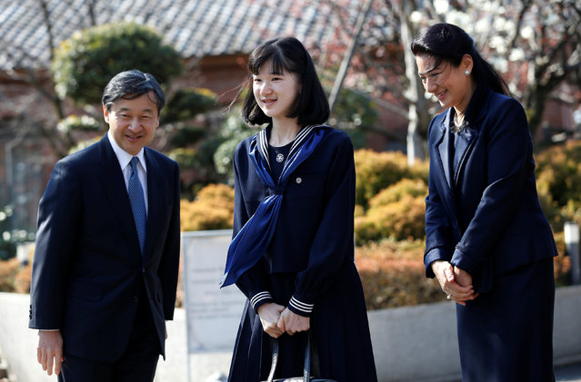 Japan's Princess Aiko (C), accompanied by her parents Crown Prince Naruhito and Crown Princess Masako, smiles at well-wishers as they attend her graduation ceremony at the Gakushuin Girls' Junior High School in Tokyo, Japan, March 22, 2017. (Photo by Issei Kato/Reuters)