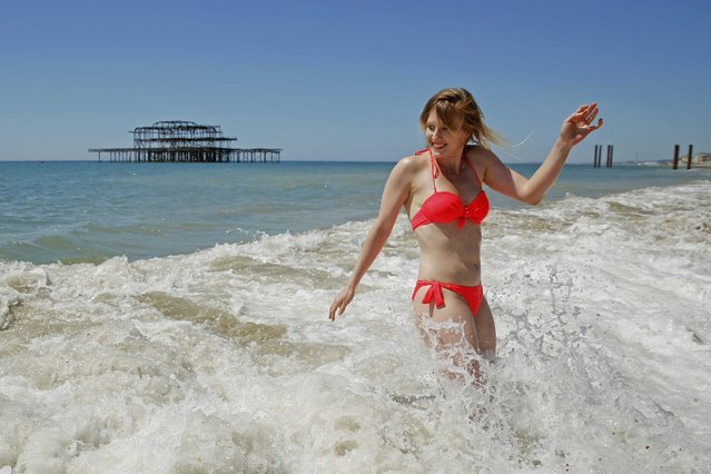 Australian singer and musician Lija Rolavs who performs as Princess Freesia is caught by a wave on a hot Summer day at Brighton beach in Britain June 30, 2015. Britain's Meteorological Office has warned of the possibility of heatwave conditions, with temperatures reaching their highest of the year on Tuesday and Wednesday. (Photo by Luke MacGregor/Reuters)