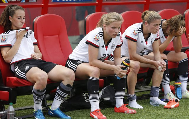 Germany players react to a 1-0 loss to England in the FIFA Women's World Cup third-place soccer match in Edmonton, Alberta, Canada, on Saturday, July 4, 2015. (Photo by Jeff McIntosh/The Canadian Press via AP Photo)