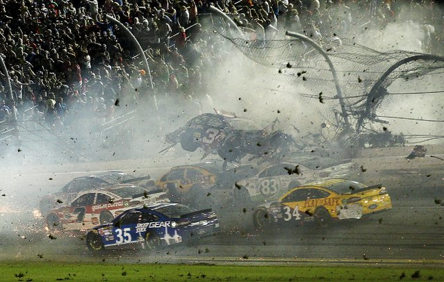 NASCAR Sprint Cup Series driver Austin Dillon's car (3) crashes against the catch fence during the finish of the Coke Zero 400 at Daytona International Speedway on  July 6, 2015. (Photo by Reinhold Matay/USA TODAY Sports)