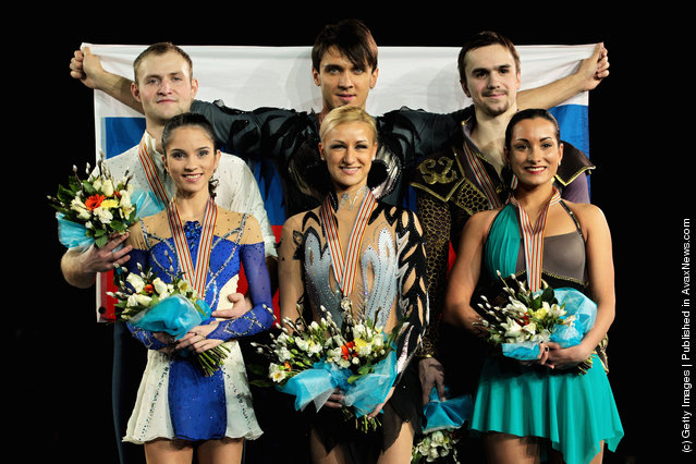 (L-R) Vera Bazarova and Yuri Larionov (silver) of Russia, Tatiana Volosazhar and Maxim Trankov (gold) of Russia and Ksenia Stolbova and Fedor Klimov of Russia (bronze) celebrate on the podium with their medals after the Pairs Free Skating during the ISU European Figure Skating Championships at Motorpoint Arena