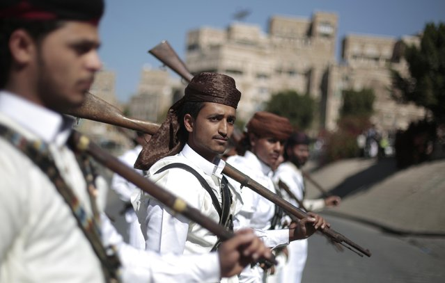 Shiite rebels, known as Houthis, wearing traditional costumes, take part in a parade by newly recruited Houthi fighters aimed at mobilizing more fighters into battlefronts to fight pro-government forces in several Yemeni cities, in Sanaa, Yemen, Thursday, January 5, 2017. (Photo by Hani Mohammed/AP Photo)
