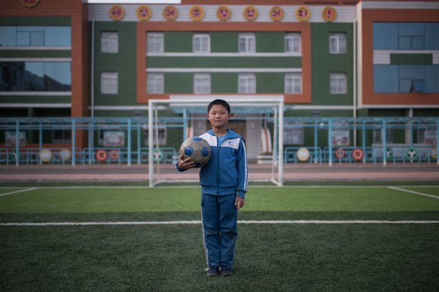 In a photo taken on April 13, 2017 Jong Kwang-Hyok (10) poses for a portrait on a football field at a school for orphans on the outskirts of Pyongyang. (Photo by Ed Jones/AFP Photo)