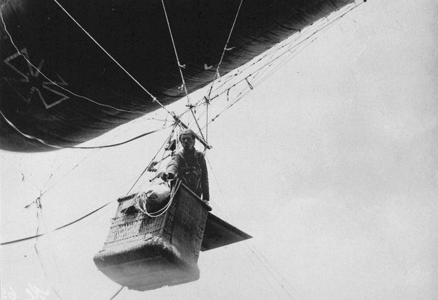 Observer in a German balloon gondola shoots off light signals with a pistol. (Photo by U.S. National Archives via The Atlantic)