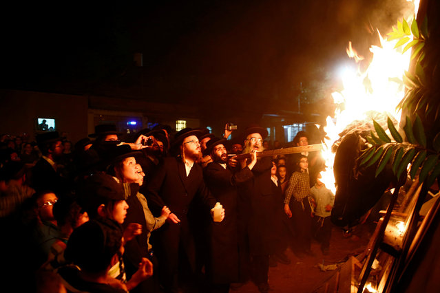 Ultra-Orthodox Jews light a bonfire during celebrations for the Jewish holiday of Lag Ba-Omer in Jerusalem's Mea Shearim neighbourhood  May 25, 2016. (Photo by Ronen Zvulun/Reuters)