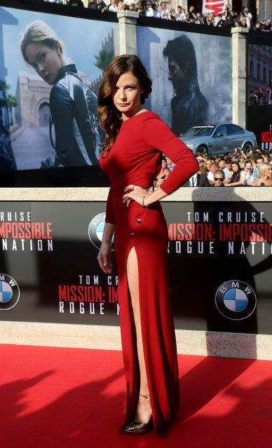 """Swedish actress Rebecca Ferguson poses for the media as she arrives for the """"Mission Impossible – Rogue Nation"""" World Premiere, at the Vienna State Opera in Vienna, Austria, Thursday, July 23, 2015. (Photo by Ronald Zak/AP Photo)"""