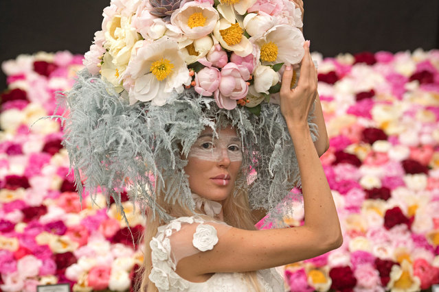 A model wears a floral headdress at the Royal Horticultural Society's Chelsea Flower show in London, Britain, May 22, 2017. (Photo by Victoria Jones/PA Wire)